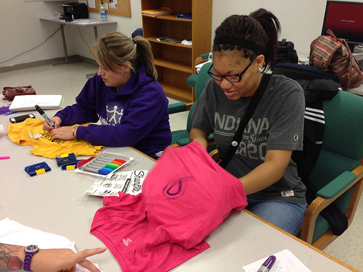 Students participate in the clothesline project to bring awareness to domestic violence. Preface photo/NATALIE MILLS