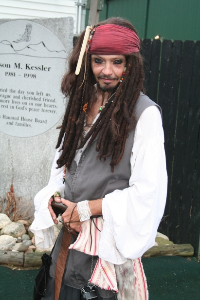 Captain Jack Sparrow, played by Dennis Davis, poses for a moment between entertaining haunt's guests. Preface photo/ KELSIE FERGUSON