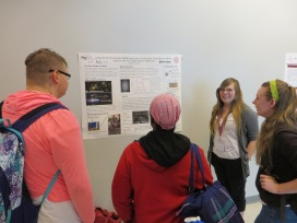 Emily Mann showing students the intrcacies of Dark Matter