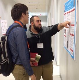 - Ridwan Jojo, right, points at his research project results in the South Wiekamp Hall Friday, April 17, 2015. (Photo/Bri Schmitt).