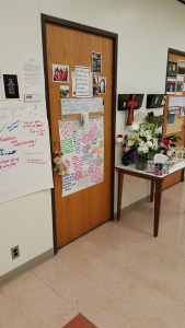 Faculty and students have turned the door to the late LuAnn Woodrick's office in Northside Hall into a makeshift memorial.  Photo Credit/Jim Irizarry
