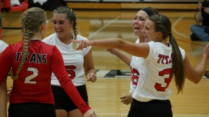Titan volleyball players celebrate a win. PHOTO/SARAH WHITEHEAD