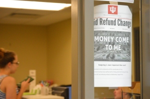 Flyers informing students of changes in financial aid policies adorn the wall of the Education and Arts Building, the temporary home of the Office of Financial Aid and Scholarships. PHOTO/C.A. PRINTUP