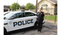Melissa Hall stands beside an IUSBPD squad car. PHOTO/IAN BROWN