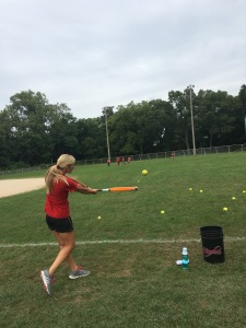 Coach Brittney Lightfoot runs pop fly drills with her outfielders. PHOTO/Casey McDonald