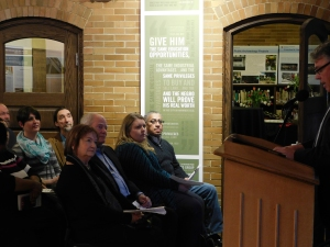 Chancellor Terry Allison makes opening remarks at the Carnegie Engaged Campus Kick-Off. In the first row, Maggie Kernan, former South Bend mayor and Indiana governor Joe Kernan, student Christine Deutscher, and LeRoy King, Executive Director of Bridges Out of Poverty, listen. PHOTO/JIM IRIZARRY